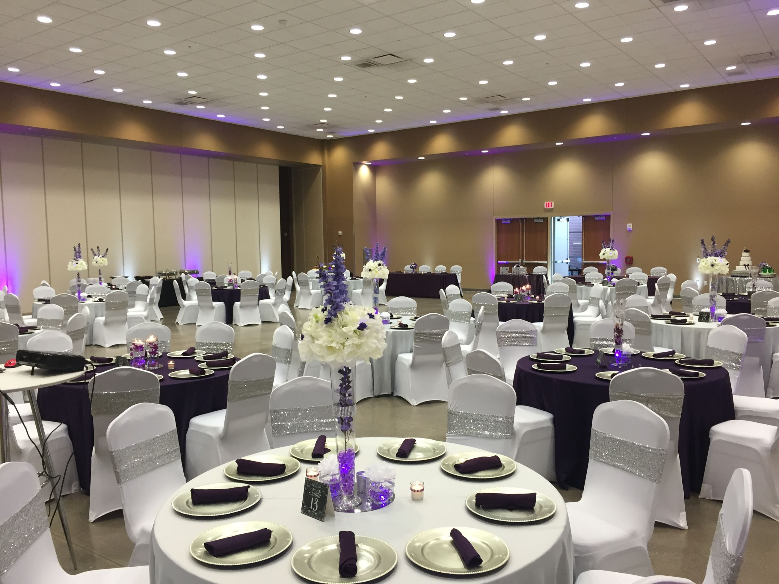 Purple and white wedding reception